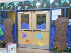 We did a luau themed book fair based on the book Chicka Chicka Boom Boom. This is the front door of the library. I created the tiki guys by projecting the clip art from the Scholastic Toolkit onto brown bulletin board paper.