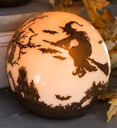 Halloween Glowing Luminary Globe | Halloween Decorations | This magical, mystical ball features a 360°-detailed Halloween scene featuring a witch in flight, bats, graveyard, haunted mansion and more. Use one or more to line stairs, path or walkway. Auto-timer turns it on to glow for 6 hours, off for 18.