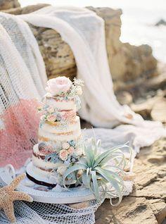 beach wedding cake - photo by Charlotte van den Berg http://ruffledblog.com/spanish-bohemian-beach-inspiration