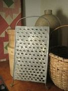 Old Footed Tin Grater