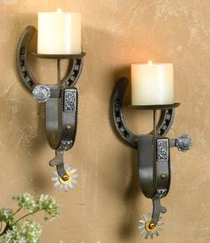 Rustic candle holders made with spurs and horseshoes. I love this idea!