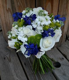 bridal bouquets with a touch of blue | ... fun bouquet of white with a touch of dark blue and bright green