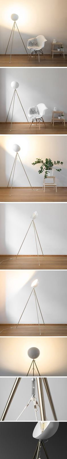 According to designer Mindaugas Petrikas, the lamp shade opening should always be pointed at a wall so that, like the flower, it looks to the bright spot, always facing the light! With its spindly legs and light color scheme, it's eye-catching without being visually cluttering. Its legs are connected by three ropes. This creates tension in only one axis, allowing the legs to move sideways with ease, but preventing them from moving back and forth.