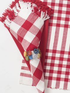 The 'Happy Picnic' napkin bundle is manifested in cheerful red and white woven stripes that pop perfectly off of its Indian cotton yarn ground. The fringe is a detail that once noticed is truly magnificent.      Shown with fringed essential napkin.