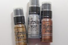 NEW Tim Holtz Metallic Distress Paints Tim Holtz Distress Paints are very fluid water based acrylic paints for multiple surfaces. Tim Holtzand Ranger Ink developed these special paints to be reactive with water just like Distress Inks and Distress Stains perfect to accomplish a wide variety of artistic techniques. The new paints are ideal for adding a burnished metallic sheen to your artwork. Use with stamps, paper, wood, metal, glass, plastic and more for a timeless matte finish on paper…