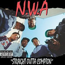 The members of N.W.A look down to the camera and point a gun to it