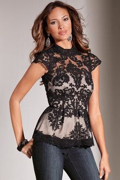 Lace peplum top - Seductive lace overlay top in a figure-flattering silhouette. Exposed back zip....