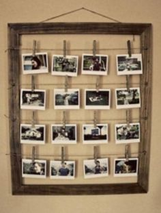 What a creative and economical way to display your favorite pictures!  An old picture frame, some twine, and clothes hangers.