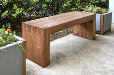 The bench had to be modern, inexpensive, load bearing (no falling apart please), and look great. This outdoor bench meets all those qualifications and more!