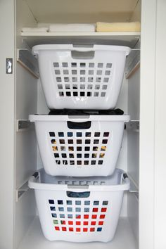 Interiors | laundry | utility room | LoveYourFloor Hanging Laundry baskets rock my world.... I might try this! In the laundry room w/o closet tho. Jason could figure it out!