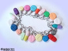 I like this, but if a doctor wears this your patients might think you& one of those doctors who thinks pills can fix anything. Best lesson I& ever learned: be careful of prescribing a pill for every ill. Pharmacy Humor, Medical Humor, Nurse Humor, Handmade Bracelets, Beaded Bracelets, Handmade Polymer Clay, Nurse Gifts, Heart Charm, Jewelry Design