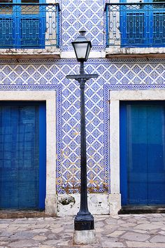Street lamp with house with blue doors, windows and balcony in historic center of S. Luis do Maranhão, Brazil | Paint + Pattern
