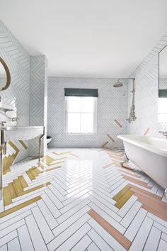 bathroom tile ideas - made a mano - Make a boring white bathroom exciting by laying tiles in a herringbone pattern and layering in a touch of color.