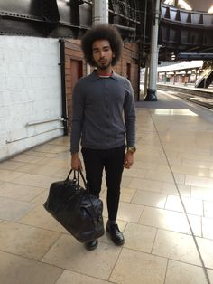 Mens Fashion at Paddington Station, London, Ben Sherman holdall, Versace cardigan, Vintage tailored trousers, Doctor Martens shoes  Watches & Fashion | WTCH.co
