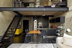 Un loft industrial, elegante y masculino.