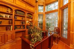A beautiful wood paneled study or office with ample shelving is just off of the foyer with double French doors and even more room for a sofa, chairs, or an upright piano not pictured.    MLS # 57867511  www.woodlandsrealtypros.com
