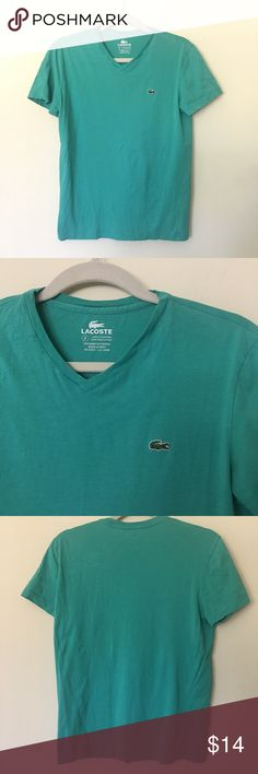 Lacoste V Neck T Shirt Lacoste V Neck T Shirt. This is worn but no holes rips or tears. Good used condition. Bermuda color. Men's XXS according to Lacoste's size guide. Can fit women's S-M. Lacoste Shirts Tees - Short Sleeve