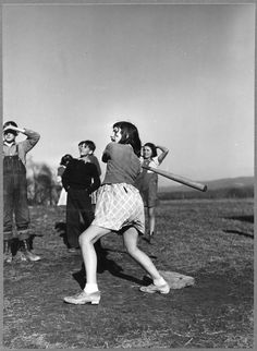 """ Soyouhit'm girl !!! A baseball game in Dailey, WV, 1941. """