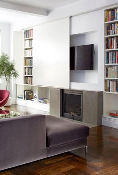 living room with hidden TV over fireplace Living Room Tv, Home And Living, Living Spaces, Modern Living, Minimalist Living, Small Living, Sliding Wall, Sliding Doors, Sliding Panels