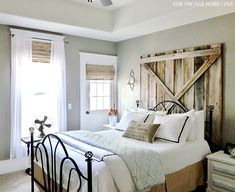 """Love the soothing color palette as well as that amazing barn door behind the headboard....awesome! <3    Taken from """"Our Vintage Home Love"""" blog"""