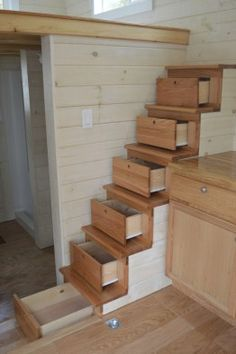 """Build it yourself! Plans are available. An 8×24 ft. """"climbing stairs"""" home with abundant storage, a side entrance, open floor plan, shed roof, and a cool baseball theme! $46,000"""