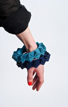 3D Printed Jewelry by Theresa Burger.Join the 3D Printing Conversation: http://www.fuelyourproductdesign.com/