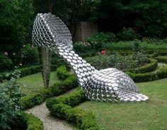 """""""Carmen Miranda"""" sculpture made of pots and lids"""