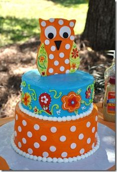 'ASHLEY'  turquoise and orange... ( DECORATE IT HOWEVER YOUR INSPIRED TOO..)  this owl doesnt need to be so big... I love the owl in the picture next to this one... BUT make it however you feel like!!       Orange and turquoise/aqua Owl Cake