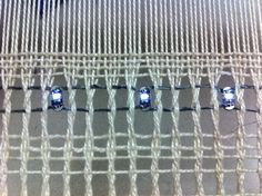 Weaving with conductive thread and LEDs.  by Marie Carmel.
