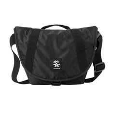 The Sling 4000 is  the perfect light and strong over the shoulder bag for your SLR camera gear and accessories.