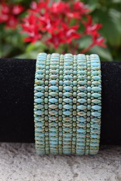 Superduo Bracelet Turquoise Beaded Bracelet Square Stitch Bracelet Seed Bead Bracelet Right Angle Weave Bracelet Cuff Bracelet by BeadsOnAWireByLisa on EtsyThis turquoise blue superduo square stitch beaded bracelet was hand stitched by me one bead at Beaded Bracelet Patterns, Woven Bracelets, Seed Bead Bracelets, Seed Bead Jewelry, Beaded Jewellery, Jewellery Designs, Jewelry Box, Colorful Bracelets, Necklaces