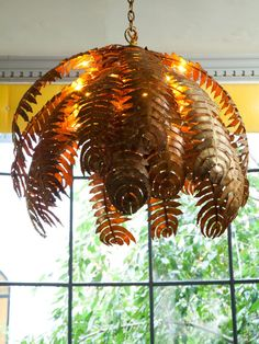 Chandelier - Gold leaf chandelier - perfect for the solarium/sun room, patio, etc....funky & fun but it's gold leaf you say.