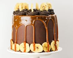 A six-inch banana layer cake frosted with dark chocolate ganache and drizzled with caramel. Topped with sea salt, dark chocolate buttercream, and banana chips.