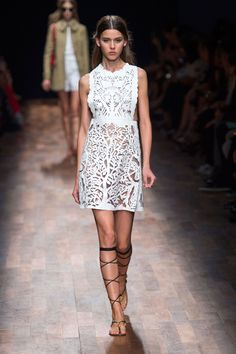 The white lacy dresses were beyond pretty, rendered in short, flared boyish silhouettes, a covered up shirt and long dress or a flirtier little mini with an open back. And it was made modern when worn under a Peter Pan-collared short trench.  Imaxtree  - HarpersBAZAAR.com