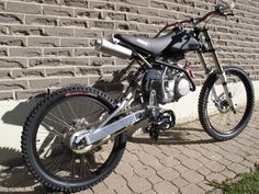 A downhill bike that you won't have to pedal uphill! Roughly 125 cc engine!