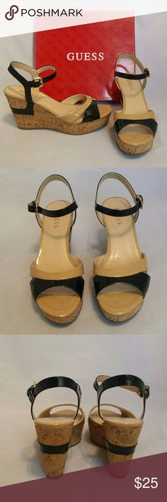 "Guess Black & Tan Cork Wedge Sandles Guess Black & Tan Cork Wedge Sandles. Style: wgcolby.  1"" platform at toes and 3.5"" at heel.  Excellent condition.  Minor wear on soles and near logo.  No stains or imperfections. Smoke free house. Guess Shoes"