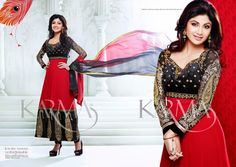 Stunning Shilpa Shetty in Red and Black Georgette Long Length Salwar Kameez embellished with zari embroidery work on the yoke part, sleeves and broad border part which add beauty to the looks.