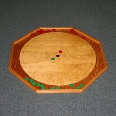 This Instructable will show you how to build your own Crokinole game board. Crokinole is a dexterity game which originated in Canada in the 1870's and has gained a large enough following that there has been a World Crokinole Championship in Tavistock, Ontario Canada every year since 1999. The rules are fairly simple. You score points by flicking your discs toward the center hole on the board while simultaneously attempting to knock your opponents discs off the board.&nbs...