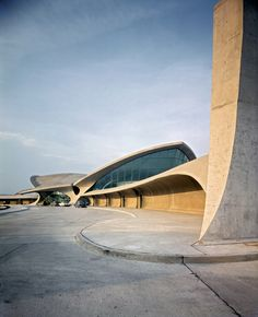 "Eero Saarinen's TWA terminal at JFK, curtain walls,free flowing curves imitating"" the spirit of flight"""