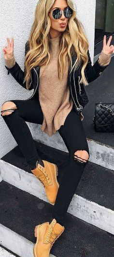 I love the black jeans with these boots! And the leather jacket. I don't like the sweater though. The color is ok but I'd wear a tight one.