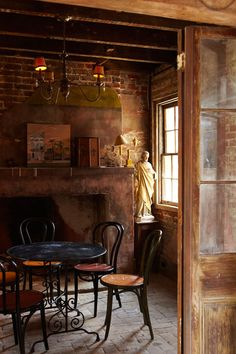Dinner in front of the fireplace in this rustic French dining room.