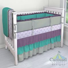Crib bedding in Lilac Geometric, Solid Emerald Turquoise, Solid Cloud Gray, Solid Aubergine Purple. Created using the Nursery Designer® by Carousel Designs where you mix and match from hundreds of fabrics to create your own unique baby bedding. #carouseldesigns
