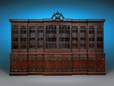 This monumental Chippendale Revival bookcase exemplifies the best of English furniture craftsmanship ~ M.S. Rau Antiques