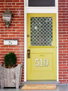 yellow front door/red brick