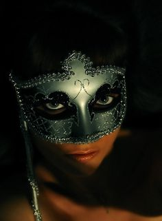 Like this one / The eyes seem mysterious and even sinister.  I love photography and this is good.