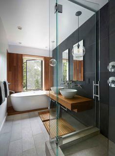teak countertop and accents, basins and tub by Toto, graphite & white stone tile