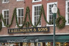 Simple holiday decorations adorn the storefront of F. Gillingham & Sons, a classic general store on Elm Street in Woodstock since 1886.