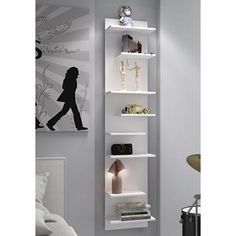 Bring graceful display to any space with this contemporary floating shelf with a crisp, modern white finish.
