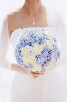 Baby blue and white bridal bouquet, perfect for a vintage style wedding with a pastel palette.