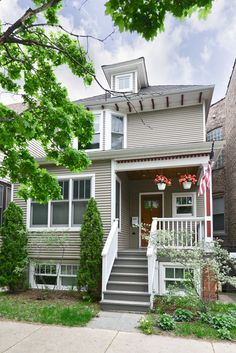 A classic craftsman exterior with intricate wood details and a covered front porch turn back time at this home for rent in Andersonville.